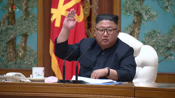 North Korean leader Kim Jong-un attends a Politburo meeting on April 11, his last public appearance in weeks. [YONHAP]