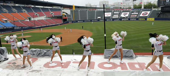 The LG Twins cheerleaders cheer for their home team at Jamsil Baseball Stadium in southern Seoul against the Doosan Bears during the KBO's season opening game on Tuesday, also Children's Day. [NEWS1]