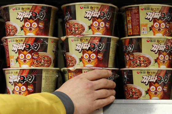 Jjapaguri instant noodle that was featured in the film Parasite, which won the Oscar for Best Picture earlier this year stacked on a shelve at a discount mart in Seoul April 21. Thanks to the Korean film's popularity ramyeon export rose. [YONHAP]