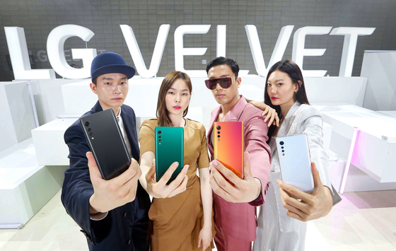Fashion models pose together with LG's new smartphone, the Velvet, in their hands at the smartphone's online launch event Thursday. LG's new smartphone will be available on May 15. [LG ELECTRONICS]