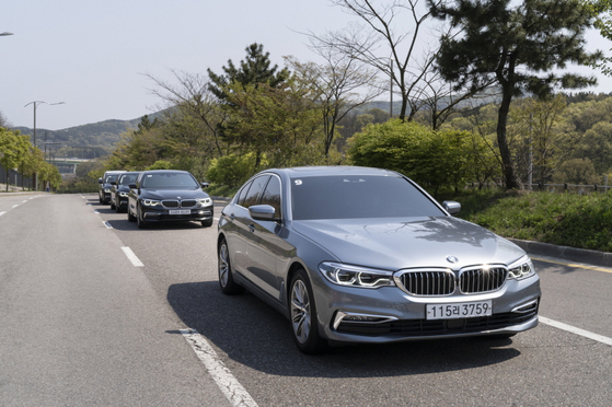 The 530e PHEV is driven down the road on Yeongjong Island during a media test drive event held earlier this month. [BMW KOREA]