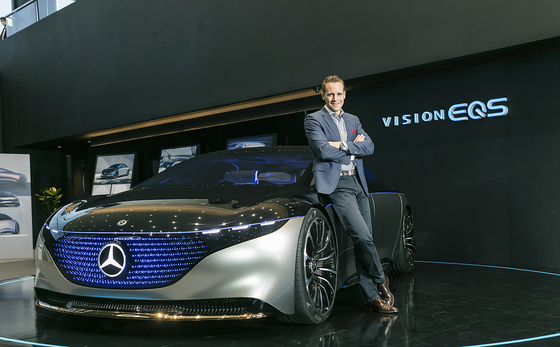 Mark Raine, product and marketing vice president at Mercedes-Benz Korea, poses next to the Vision EQS concept model at the company's showroom in Goyang, Gyeonggi. [MERCEDES-BENZ KOREA]