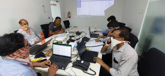 LG Polymer staff answer calls from locals at the hot line center set up at LG Chem affiliate's factory in Visakhapatnam, India, Thursday, following a gas leak that killed 12 people. The Korean company said Thursday it will conduct surveys to determine health and environmental impacts at the site, disclose the results and create a comprehensive support plan and carry out projects to support the local community based on residents' suggestions. [LG CHEM]