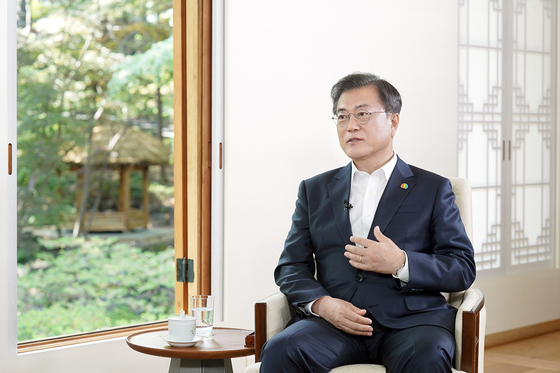 President Moon Jae-in speaks at the Blue House in an interview on the May 18 Democratization Movement in Gwangju on Sunday, the eve of the 40th anniversary of the uprising. [NEWS1]