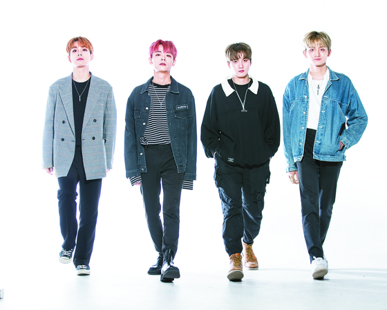 Four-member band Lucy released a debut single earlier this month. Lucy consists of, from left, vocalist Choi Sang-yeop, violinist and frontman Shin Ye-chan, drummer Shin Gwang-il and bassist and producer Cho Won-sang. [KWON HYUK-JAE]