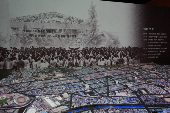 Located on the third floor of the museum, a motion picture screen and map show where in the city the civilian-military scuffles took place during the May 18 movement in 1980. [ESTHER CHUNG]