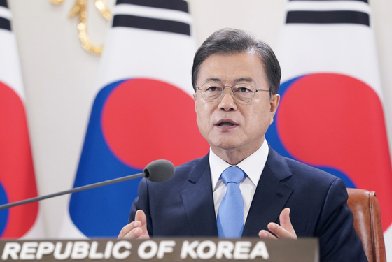 President Moon Jae-in gives a speech for the World Health Assembly's video session on Monday.  [YONHAP]