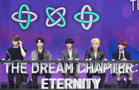 """Tomorrow X Together in an online press conference in Seoul on Monday to mark the release of their second EP, """"The Dream Chapter: Eternity."""" [PARK SE-WAN]"""