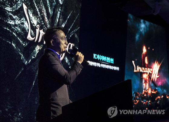 In this file photo, Kim Taek-jin, CEO of online game publisher NCSOFT Corp., gives a keynote speech in Seoul on May 15, 2018, on the anniversary of the Lineage M. [YONHAP]