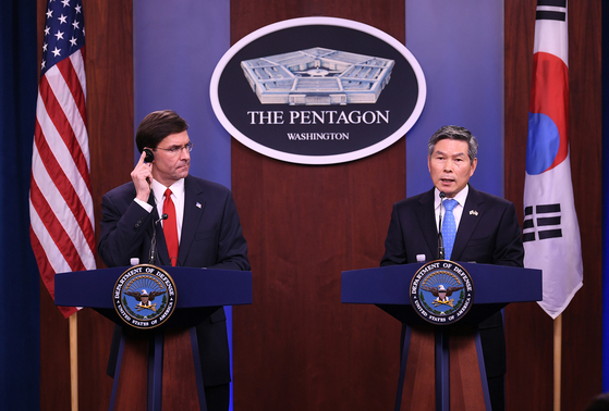 Korean Defense Minister Jeong Kyeong-doo, right, and U.S. Secretary of Defense Mark Esper hold a joint press conference in Washington in February. [YONHAP]