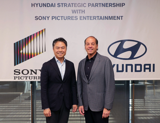 Hyundai Motor's Executive Vice President and Chief Marketing Officer Cho Won-hong, left, and Jeffrey Godsick, Sony Pictures Entertainment's executive vice president of global partnerships and brand management, pose after signing a promotional partnership. [HYUNDAI MOTOR]
