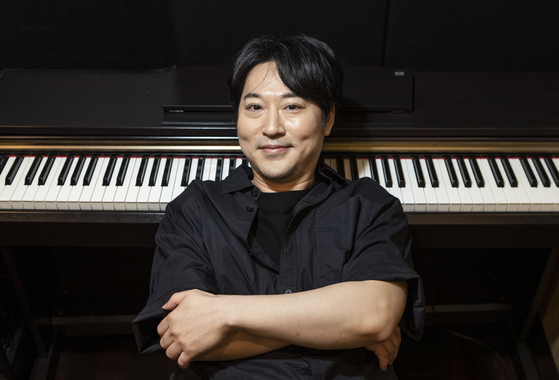 Pianist Yiruma poses for a photo during a recent interview with the JoongAng Ilbo. [KWON HYUK-JAE]