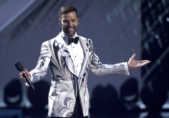 "This Nov. 14, 2019, file photo shows host Ricky Martin at the 20th Latin Grammy Awards in Las Vegas. Martin released an EP Thursday, May 29, called ""Pausa."""
