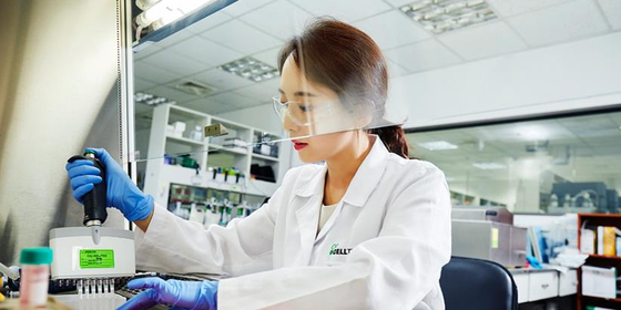 A Celltrion researcher tests for the development of Covid-19 antiviral antibody treatment in the laboratory. [CELLTRION]