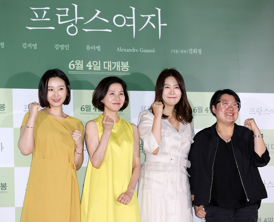 "From left, actors Ryu A-bel, Kim Ho-jang, Kim Ji-young and director Kim Hee-jung pose for the camera at a press event for upcoming film 'A French Woman"" held at the Konkuk University Entrance branch of Lotte Cinema, eastern Seoul, on Monday. The film is about Mi-ra, who went to France with the dream of becoming an actor 20 years ago and her return to Seoul to meet her friends. The film premieres on June 4. [NEWS1]"