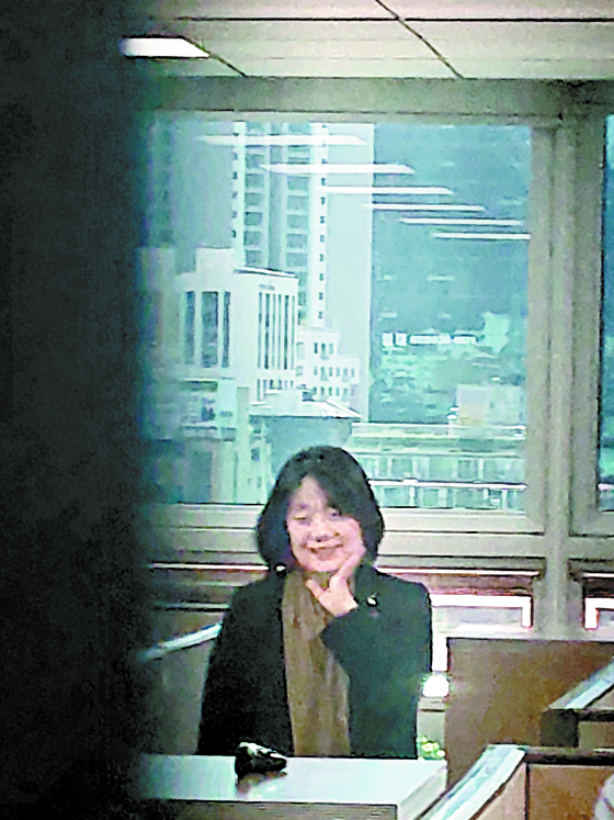 Rep. Yoon Mee-hyang, a newly-elected lawmaker of the ruling Democratic Party, smiles in her office at the National Assembly on Monday. All accusations against her, including her alleged misuse of donations for a civic group led by her, could not stop her from becoming a legislator. [YONHAP]