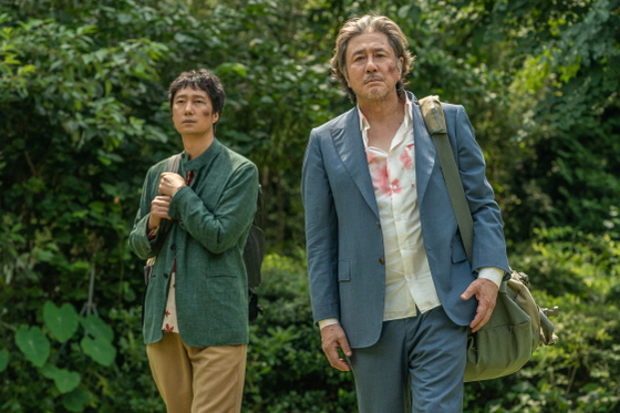 """Scene from """"Heaven: To the Land of Happiness."""" Actors Park Hae-il, left, and Choi Min-sik feature as lead roles. [TRIPLE PICTURES]"""