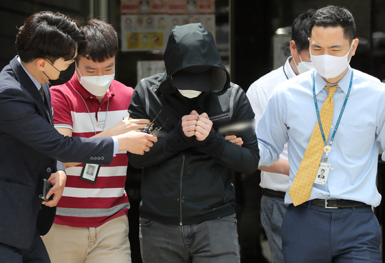A man accused of being a paying member of 'Baksa Room' is taken to the Seoul Central District Court in Seocho District, southern Seoul, on Wednesday, where a judge held a hearing to decide whether to issue a warrant to detain him. Baksa Room was an online chat room on Telegram allegedly run by Cho Ju-bin, who is accused of selling underage pornography. [NEWS1]