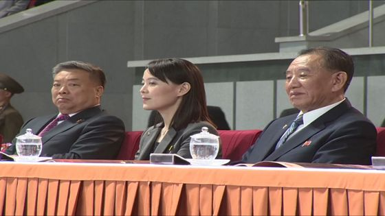 First Vice Department Director Kim Yo-jong, center, and Kim Yong-chol, vice chairman of the Central Committee of the Workers' Party, right, watch a mass game in Pyongyang in June 2019. According to state media, the two figures were responsible for instructions laid out Tuesday ordering that all communications with South Korea be severed. [YONHAP]