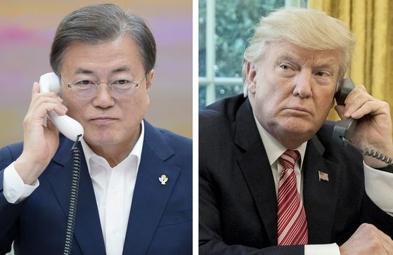 President Moon Jae-in talks on the phone with U.S. President Donald Trump on June 1 about Trump's invitation of Korea to a G7 Summit in the United States in September. [YONHAP]