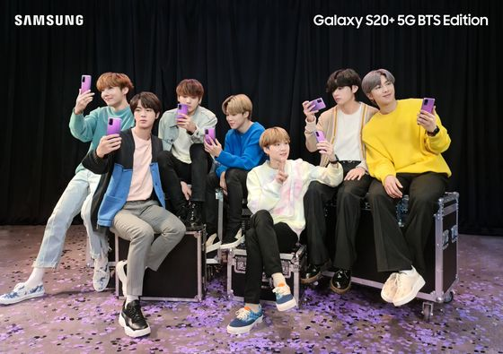Boy band BTS poses with Samsung Electronics' BTS edition smartphone and ear buds. [SAMSUNG ELECTRONICS]