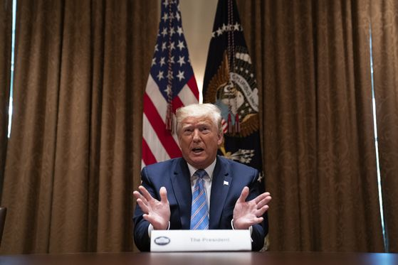 U.S. President Donald Trump says he will cut the number of U.S. troops in Germany by half during a roundtable at the White House in Washington on Monday. [AP/YONHAP]