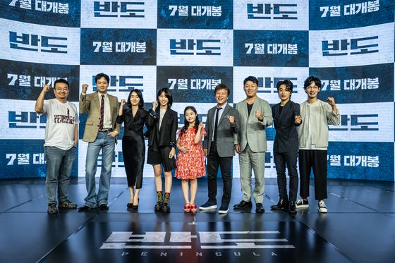 """From left, director Yeon Sang-ho, actors Gang Dong-won, Lee Jung-hyun, Lee Re, Lee Ye-won, Kwon Hae-hyo, Kim Min-jae, Koo Kyo-hwan and Kim Do-yoon pose for camera at the online press event for the highly-anticipated zombie blockbuster """"Peninsula."""" [NEXT ENTERTAINMENT WORLD]"""