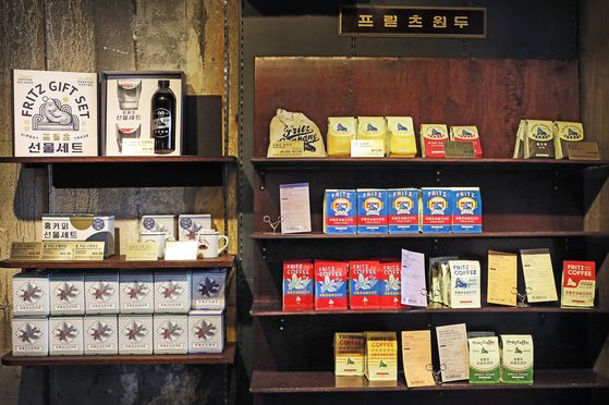 The coffee brand has lots of merchandise available featuring its retro-style logo and mascot. [PARK SANG-MOON]