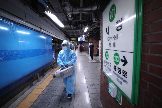 City Hall Station of lines No. 1 and 2 in Jung District, central Seoul, is disinfected Wednesday after Seoul Metro announced three Covid-19 cases among its workers there this week. [NEWS1]