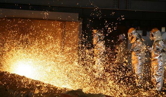 Workers make steel at Pohang Steel Works in North Gyeongsang. [POSCO]