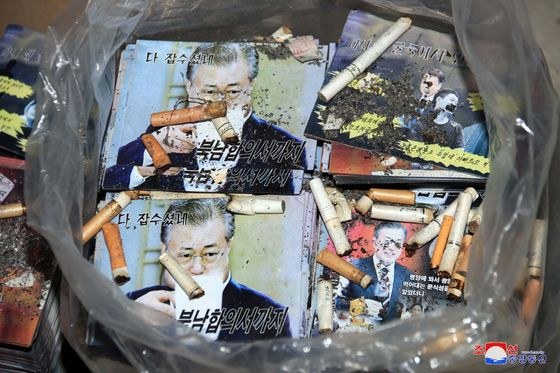 A photo released by the North's state-run Korean Central News Agency on Saturday, showing cigarette butts in a bag full of leaflets made by the regime condemning South Korean President Moon Jae-in. The North announced it will be dispatching such propaganda fliers toward the South in the near future. [YONHAP]