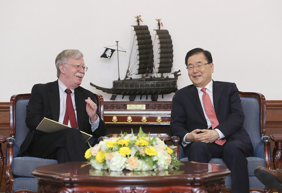 Former U.S. White House National Security Advisor John Bolton, left, and his counterpart Chung Eui-yong, South Korea's Blue House national security office director, hold discussions at the Blue House in July 2019. [YONHAP]