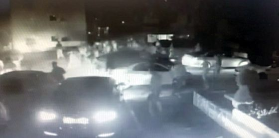 A CCTV image from a parking lot in Gimhae, South Gyeongsang, last Saturday night, released by police, shows some 30 people fighting. [YONHAP]