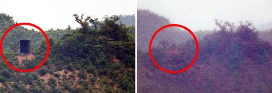 North Korea removed propaganda loudspeakers in the demilitarized zone on Wednesday, as shown on the right, just two days after setting them up on Monday afternoon. [YONHAP]