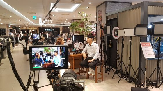 A live commerce show is filmed at a Lotte Department Store. [LOTTE SHOPPING]