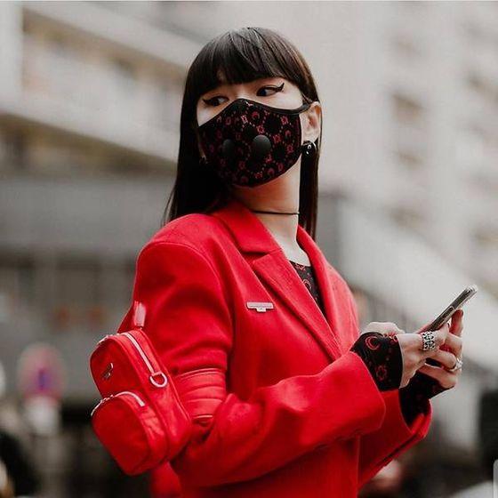 Photo of Japanese model Kozue Akimoto participating in 2020 Paris Fashion Week wearing a mask designed by Marine Serre. [SCREEN CAPTURE]