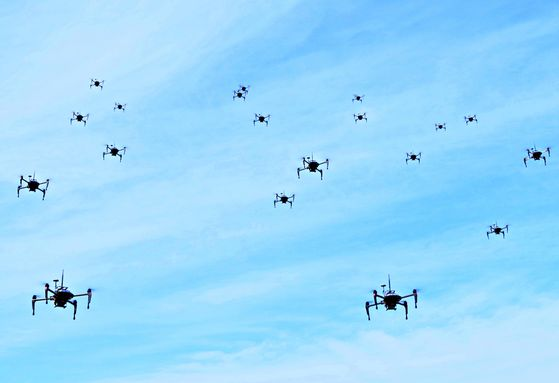 Dozens of military-use drones developed by the Agency for Defense Development are flown during a test in March. [PARK YONG-HAN]