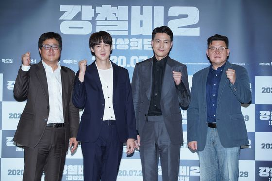 """From left, actors Kwak Do-won, Yoo Yeon-seok, Jung Woo-sung and director Yang Woo-seok pose for a photo during an online press event for """"Steel Rain 2: Summit"""" on Thursday. [LOTTE ENTERTAINMENT]"""