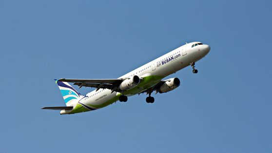 An aircraft of Air Busan flies in the sky. The budget carrier starts flights to Shenzhen, a coastal city in the south of Guangdong Province in China, on July 17. [AIR BUNSAN]