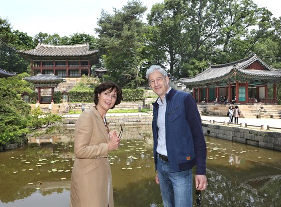 Ambassador of the Netherlands to Korea, Joanne Doornewaard, left, and her husband, Wouter Verhey, agricultural counselor at the Embassy of the Netherlands in Beijing, at the secret garden of Changdeok Palace, a Unesco World Heritage site in central Seoul, on May 26. [PARK SANG-MOON]