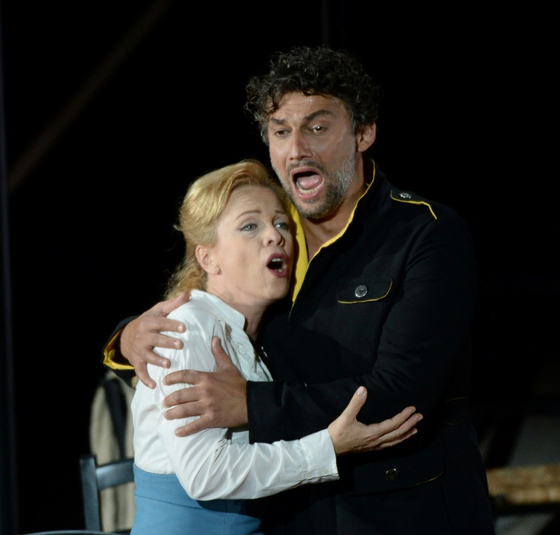 "Tenor Jonas Kaufmann, right, as Don Jose and lyric soprano Inva Mula as Micaela perform during a rehearsal of the opera ""Carmen"" by Georges Bizet on July 5, 2015. [AFP/YONHAP]"
