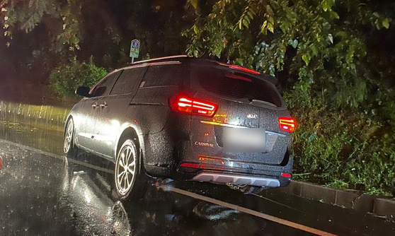 The car where Ju-ne, Jay and a man in his 20s were in, drove into a concrete retaining wall in South Gyeongsang, Monday. [YONHAP]