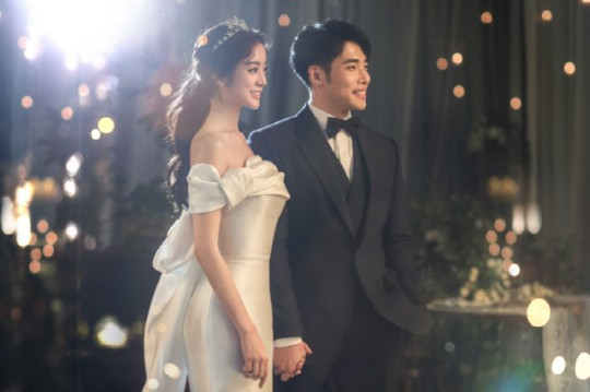 Former Wonder Girls member Woo Hye-rim, left, and extreme taekwondo player Shin Min-cheol, right, tied the knot on July 5, after seven years of dating. [RRR ENTERTAINMENT]