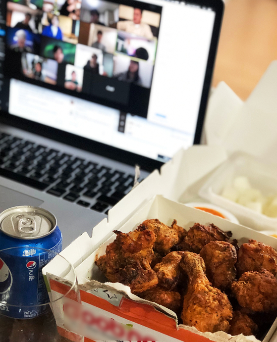 Some companies are holding corporate dinners online, talking to each other through video conferencing services like Zoom while ordering food to be delivered to their homes. [GREPP]