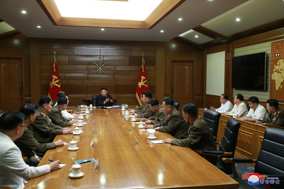 North Korean leader Kim Jong-un, center, presides over a Central Military Commission (CMC) expanded meeting on Saturday, in a photograph released by state media. [YONHAP]