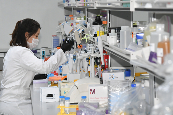 A GC Pharma researcher develops a plasma treatment in Yongin, Gyeonggi. [YONHAP]