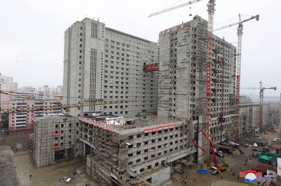 Pyongyang General Hospital under construction, in a photograph released by state media. Several floors are still missing, despite the hospital's completion deadline for October nearing. [YONHAP]