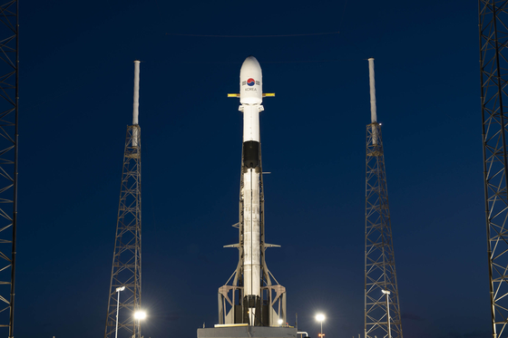 Korea's first military communications satellite, the Anasis-II, sits atop SpaceX's Falcon-9 rocket as it is readied for launch on Monday. [DEFENSE ACQUISITION PROGRAM ADMINISTRATION]