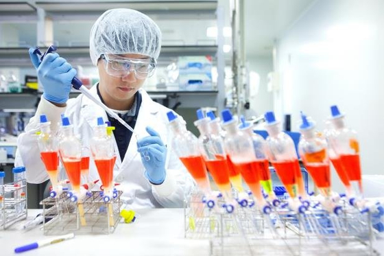 An SK Bioscience researcher conducts tests at the company's lab. [SK BIOSCIENCE]