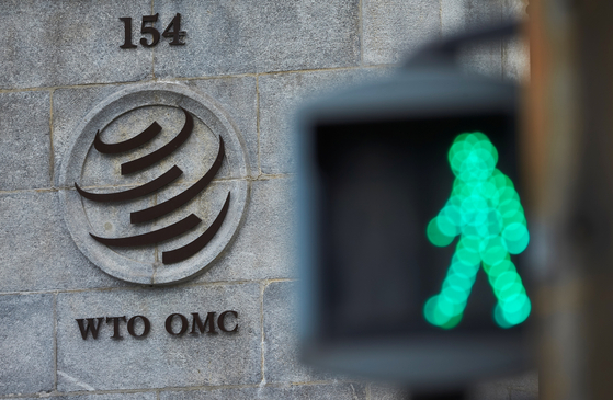 A logo is pictured in front of the World Trade Organization (WTO) in Geneva, Switzerland. [REUTERS]